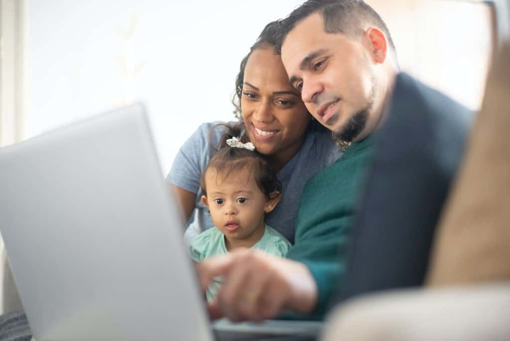 Family worshipping online with their child